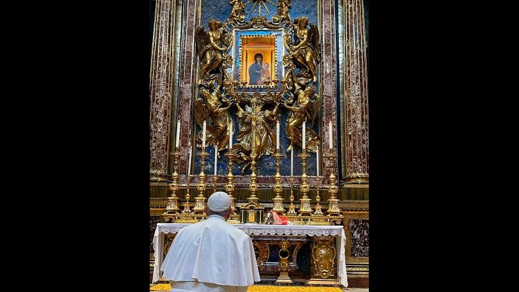 Pope Francis prays at the feet of the ancient icon of Our Lady