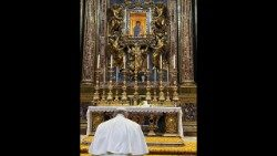 Pope Francis bows his head in prayer before Our Lady's image in St. Mary Major