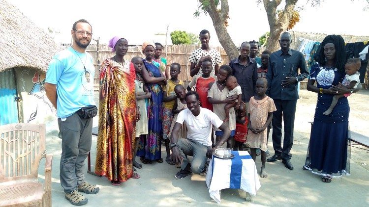 Bishop-elect Christian Carlassare with his community in South Sudan