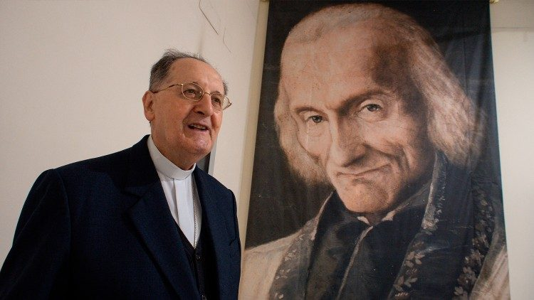 Congregation for the Clergy - Cardinal Stello next to a photo of Saint John Vianney