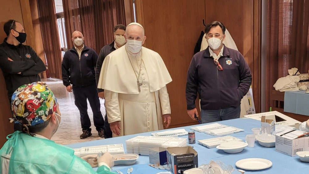 Pope Francis observes process for giving vaccinations