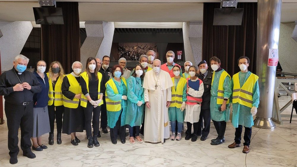 Pope Francis visits with volunteers, nurses and doctors assisting with vaccinations