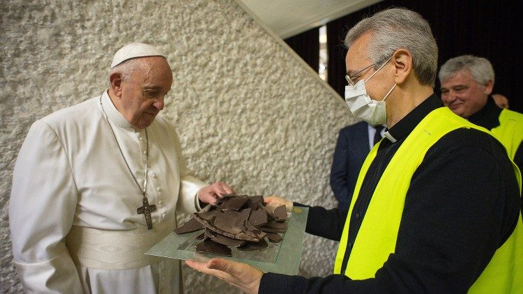 Pope Francis accepts a piece of chocolate