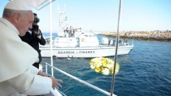 Pope Francis throwing a wreath in the sea in Lampedusa, Italy, on July 8, 2013, in memory of the many  who drowned trying to reach Europe.